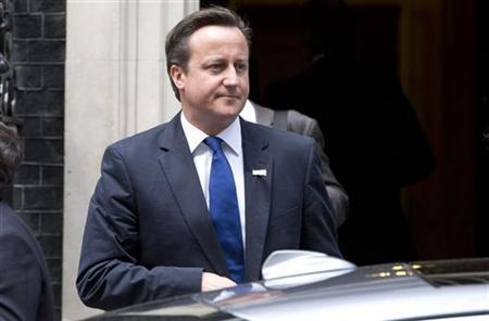 Prime Minister David Cameron leaves Downing Street in London August 2, 2012. REUTERS/Neil Hall