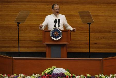Philippine President Benigno Aquino gestures as he delivers his speech during his third State of the Nation Address at the House of Representatives in Quezon City, Metro Manila July 23, 2012. REUTERS/Cheryl Ravelo