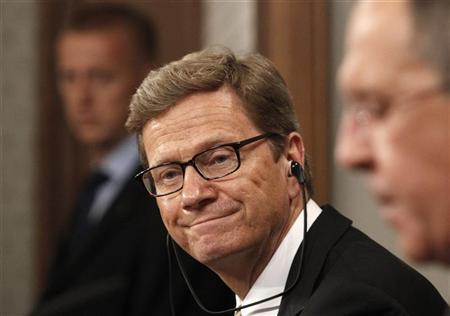 German Foreign Minister Guido Westerwelle (C), accompanied by his Russian counterpart Sergei Lavrov (R), attends a news conference in Moscow, July 5, 2012. REUTERS/Sergei Karpukhin