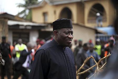 Nigeria's President Goodluck Jonathan stands as he inspects site of a plane crash at Iju-Ishaga neighbourhood in Lagos June 4, 2012. REUTERS/Akintunde Akinleye