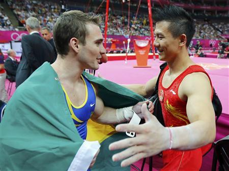 Brazil's Arthur Nabarrete Zanetti (L) celebrates winning a gold medal with silver medallist China's Chen Yibing in the men's gymnastics rings final in the North Greenwich Arena during the London 2012 Olympic Games August 6, 2012. REUTERS/Mike Blake