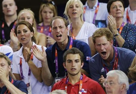 Britain's Prince William (C), his wife Catherine (L), Duchess of Cambridge and Prince Harry cheer for the British team as they watch the track cycling event at the Velodrome during the London 2012 Olympic Games August 2, 2012. REUTERS/Cathal McNaughton