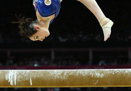 Russia's Aliya Mustafina competes in the balance beam during the women's individual all-around gymnastics final in the North Greenwich Arena during the London 2012 Olympic Games August 2, 2012. REUTERS/Mike Blake