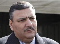 Архивное фото Рияда Хиджаба, 6 июня 2012 г. Премьер-министр Сирии Рияд Хиджаб, покинувший администрацию Башара Асада и примкнувший к оппозиции, отправится в Катар, сообщил его представитель. REUTERS/Khaled Al Hariri