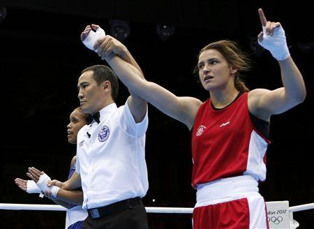 Ireland's Katie Taylor (R) is declared the winner over Britain's Natasha Jonas after their quarterfinal Women's Light (60kg) boxing match at the London Olympic Games August 6, 2012. REUTERS/Murad Sezer