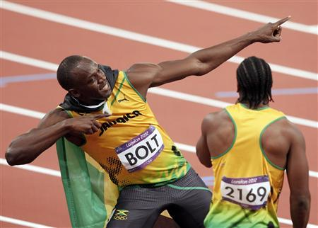 Jamaica's Usain Bolt celebrates with second-placed compatriot Yohan Blake (R) after winning the men's 100m final during the London 2012 Olympic Games at the Olympic Stadium August 5, 2012. REUTERS/Gary Hershorn
