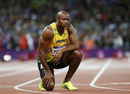 Jamaica's Asafa Powell looks at the scoreboard after running in the men's 100m final during the London 2012 Olympic Games at the Olympic Stadium August 5, 2012. Powell finished in eighth place. REUTERS/Lucy Nicholson
