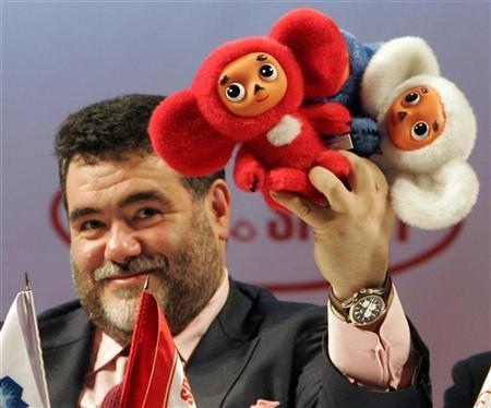 Chairman of the Bosco di Ciliegi group Mikhail Kusnirovich holds up the official mascots of the Russian team for the 2014 Sochi Olympics in Moscow October 28, 2009. REUTERS/Miklhail Voskresensky