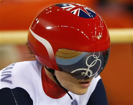 The Olympic rings are reflected in Britain's Victoria Pendleton's visor as she competes during the track cycling women's sprint 1/8 finals at the Velodrome during the London 2012 Olympic Games August 5, 2012. REUTERS/Paul Hanna