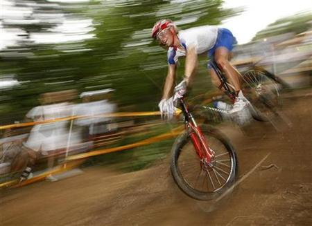 Liam Killeen of Britain competes in the men's cross-country mountain bike cycling competition at the Beijing 2008 Olympic Games August 23, 2008. REUTERS/Tim Wimborne