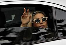 U.S. singer Lady Gaga waves to fans upon arriving at the JetQuay CIP (Commercially Important People) terminal at Changi Airport in Singapore May 26, 2012. REUTERS/Tim Chong