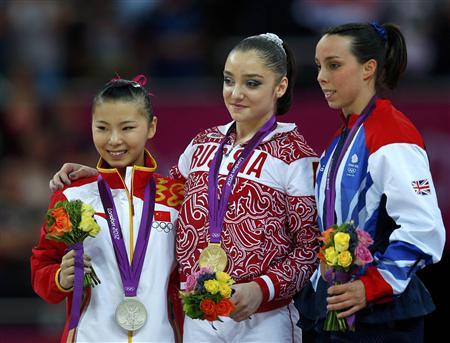 Aliya Mustafina (C) of Russia celebrates winning a gold medal with silver medallist He Kexin (L) of China and bronze medallist Elizabeth Tweddle of Britain at the women's gymnastics asymmetric bars final in the North Greenwich Arena during the London 2012 Olympic Games August 6, 2012. REUTERS/Brian Snyder