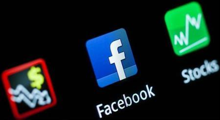 A Facebook application logo is pictured on a mobile phone in this photo illustration taken in Lavigny May 16, 2012. REUTERS/Valentin Flauraud/Files