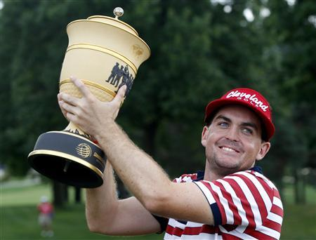Keegan Bradley of the U.S. raises the winner's trophy after the final round of the WGC-Bridgestone Invitational golf tournament in Akron, Ohio, August 5, 2012. Bradley stunningly won the WGC-Bridgestone Invitational by one shot on Sunday after playing partner Jim Furyk, a stroke in front playing the last, double-bogeyed the 18th to tumble back into a tie for second. REUTERS/Matt Sullivan