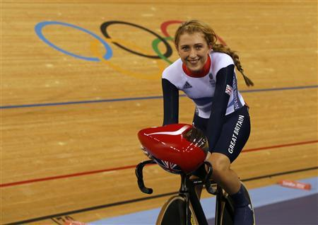 Britain's Laura Trott smiles after the track cycling women's omnium flying lap 250m time trial at the Velodrome during the London 2012 Olympic Games August 6, 2012. Trott won the time trial to lead the women's omnium event. REUTERS/Paul Hanna