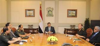 Egypt's President Mohamed Mursi (C) meets with his senior security officials, Field Marshal Hussein Tantawi (3rd L) , Chief Intelligence Minister Murad Muwafi (R) and Armed Forces Chief of Staff Sami Anan (2nd R) at the presidential palace in Cairo during an emergency meeting after Islamist gunmen killed at least 15 Egyptian soldiers near the Rafah border crossing with Gaza August 5, 2012. REUTERS/Egyptian Presidency/Handout