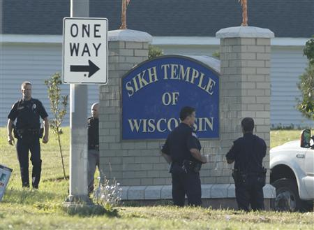 Police stand outside the Sikh Temple of Wisconsin in Oak Creek, Wisconsin, August 6, 2012. REUTERS/John Gress