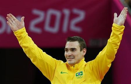 Brazil's Arthur Nabarrete Zanetti celebrates on the podium in the men's gymnastics rings victory ceremony in the North Greenwich Arena during the London 2012 Olympic Games August 6, 2012. REUTERS/Brian Snyder