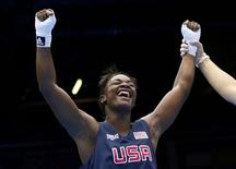 Claressa Shields of the U.S. is declared the winner over Sweden's Anna Laurell (not shown) after their quarterfinal Women's Middle (75kg) boxing match at the London Olympic Games August 6, 2012. REUTERS/Murad Sezer