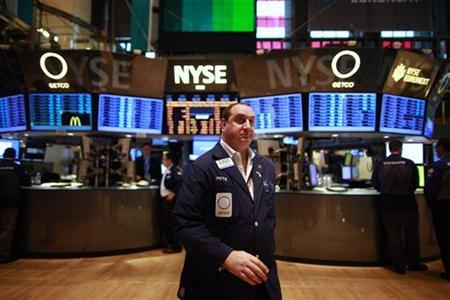 A trader works on the floor of the New York Stock Exchange June 15, 2012. REUTERS/Eric Thayer