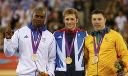 Britain's gold medallist Jason Kenny (C) stands with France's silver medallist Gregory Bauge (L) and Australia's bronze medallist Shane Perkins during the victory ceremony after the track cycling men's sprint gold finals at the Velodrome during the London 2012 Olympic Games August 6, 2012. REUTERS/Paul Hanna