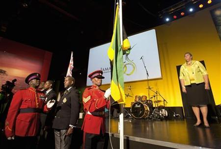 Jamaica's flag is raised to celebrate the country's 50th anniversary of its independence from Britain during the London 2012 Olympic Games at the Jamaica House in London August 6, 2012 REUTERS/Neil Hall