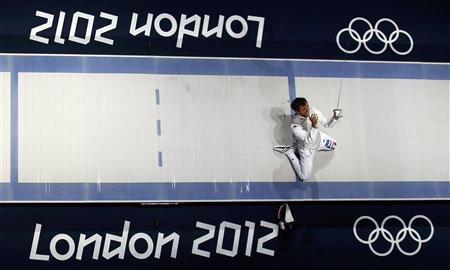 REFILE - CORRECTING BYLINE Italy's Andrea Baldini celebrates his team's victory at the end of his men's foil team gold medal fencing match against Japan's Yuki Ota at the ExCel venue at the London 2012 Olympic Games August 5, 2012. REUTERS/Suzanne Plunkett