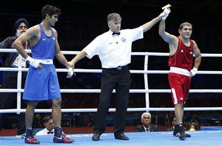 Uzbekistan's Abbos Atoev (R) is declared the winner over India's Vijender during their quarterfinal Men's Middle (75kg) boxing match at the London Olympic Games August 6, 2012. REUTERS/Murad Sezer
