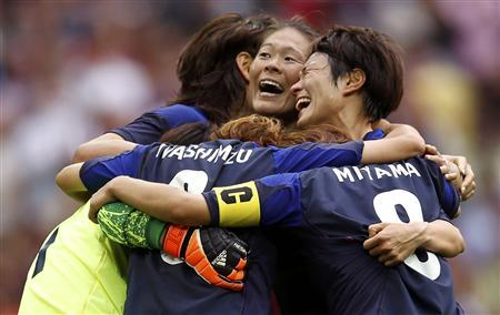 Japan celebrates after defeating France in the women's semi-final soccer match at Wembley Stadium in London at the London Olympic Games, August 6, 2012. REUTERS/Damir Sagolj