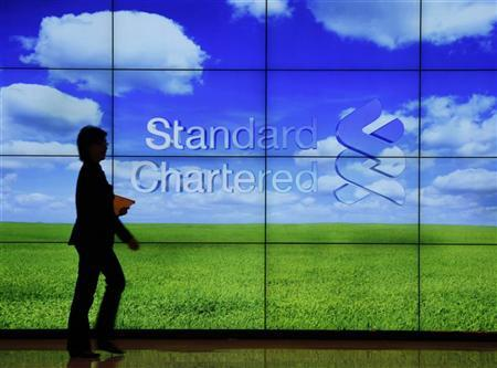 A staff member walks inside a priority banking service area of a Standard Chartered bank in Hong Kong August 1, 2012. REUTERS/Bobby Yip
