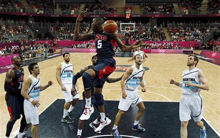 Kevin Durant (C) of the U.S. reacts after a dunk against Argentina during their men's preliminary round Group A basketball match at the Basketball Arena during the London 2012 Olympic Games August 6, 2012. REUTERS/Mike Segar