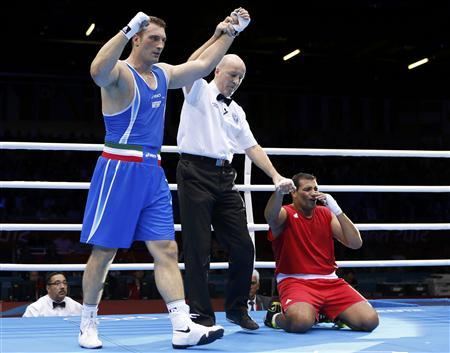 Italy's Roberto Cammarelle (L) is declared the winner over Mohammed Arjaoui of Morocco after their quarterfinal Men's Super Heavy (+91kg) boxing match at the London Olympic Games August 6, 2012. REUTERS/Murad Sezer