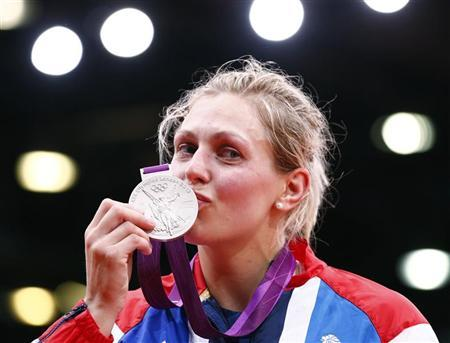 Silver medallist Britain's Gemma Gibbons kisses her medal as she celebrates during the awards ceremony for the women's -78kg judo competition at the London 2012 Olympic Games August 2, 2012. REUTERS/Darren Staples