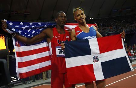 Dominican Republic's Felix Sanchez (R), who won gold, and second placed Michael Tinsley of the U.S. pose with their national flags after the men's 400m hurdles final at the London 2012 Olympic Games at the Olympic Stadium August 6, 2012. REUTERS/Kai Pfaffenbach