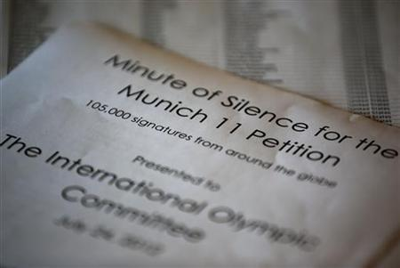 A petition for the minute of silence is presented to reporters by Ankie Spitzer and Ilana Romano in London July 25, 2012. REUTERS/Damir Sagolj
