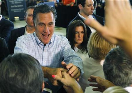 U.S. Republican presidential candidate Mitt Romney shakes hands with supporters after a campaign event in Golden, Colorado August 2, 2012. REUTERS/Rick Wilking