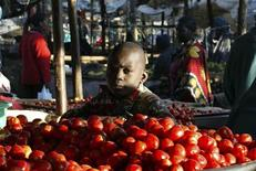 A boy sells tomatoes at an open-air market in Nairobi June 11, 2009. REUTERS/Noor Khamis