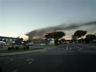 A plume of smoke emits from a fire that broke out at a Chevron oil refinery in Richmond, California August 6, 2012. REUTERS/Brady Reddall