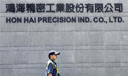 A security guard patrols at Hong Hai headquarters in Tucheng, Taipei county, June 8, 2010.REUTERS/Pichi Chuang