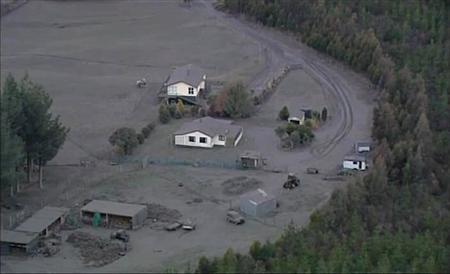 Ash from New Zealand's Mount Tongariro covers houses and farmland in this still image taken from video, August 7, 2012. REUTERS/TV3 via Reuters TV