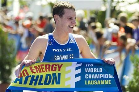 Jonathan Brownlee of Britain reacts on the finish line after winning the ITU Team Triathlon World Championship in Lausanne, August 21, 2011. REUTERS/Valentin Flauraud