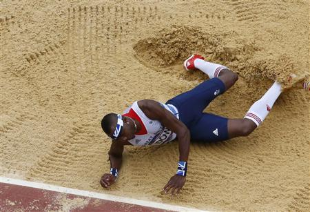 Britain's Phillips Idowu competes in the men's triple jump qualification during the London 2012 Olympic Games at the Olympic Stadium August 7, 2012. REUTERS/Pawel Kopczynski