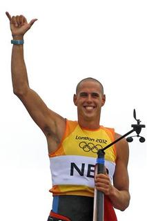 Netherlands' Dorian Van Rijsselberge celebrates winning the men's RS-X sailing class at the London 2012 Olympic Games in Weymouth and Portland, southern England, August 7, 2012. REUTERS/Benoit Tessier