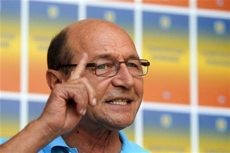 Romania's suspended President Traian Basescu addresses media in Bucharest August 5, 2012. REUTERS/Bogdan Cristel