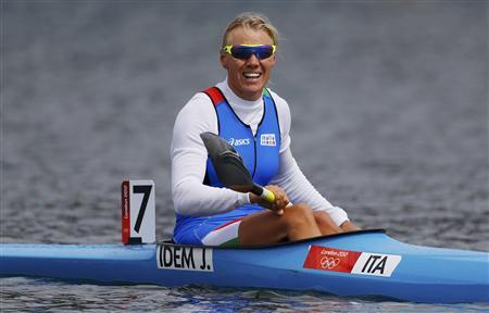 Italy's Josefa Idem reacts after competing in the women's kayak single (K1) 500m semifinal at the Eton Dorney during the London 2012 Olympic Games August 7, 2012. REUTERS/Darren Whiteside