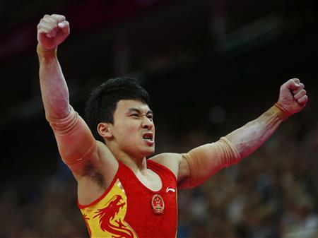 China's Feng Zhe reacts after competing in the men's gymnastics parallel bars final in the North Greenwich Arena during the London 2012 Olympic Games August 7, 2012. REUTERS/Brian Snyder
