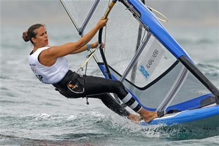 Spain's Marina Alabau Neira stands on her windsurfing board during the first race of the women's RS-X class at the London 2012 Olympic Games in Weymouth and Portland, southern England, July 31, 2012. REUTERS/Benoit Tessier