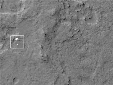 The High Resolution Imaging Science Experiment (HiRISE) camera aboard NASA's Mars Reconnaissance orbiter, captures the Curiosity rover still connected to its 51-foot-wide (almost 16 meter) parachute as it descends towards its landing site at Gale Crater on August 5, 2012, in this handout image courtesy of NASA. REUTERS/NASA/Mars Science Laboratory/Handout