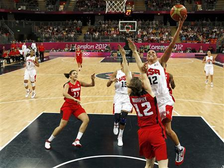 Diana Taurasi (12) of the U.S. shoots over Canada's Lizanne Murphy in the women's quarterfinal basketball match at the Basketball Arena in London during the London 2012 Olympic Games August 7, 2012. REUTERS/Sergio Perez