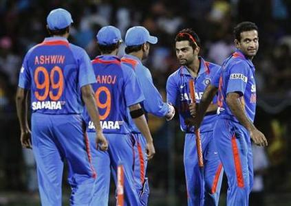India's vice captain Virat Kohli (2nd R) celebrates with his teammates after winning their Twenty20 cricket match against Sri Lanka in Pallekele August 7, 2012. REUTERS/Dinuka Liyanawatte